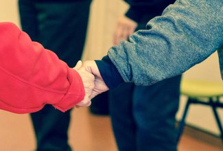 Canva - 2 Persons  Holding Their Hands.jpg