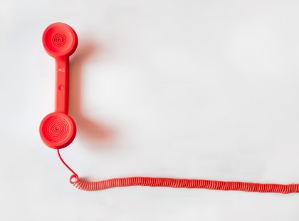 Canva - Red Corded Telephone on White Suraface.jpg